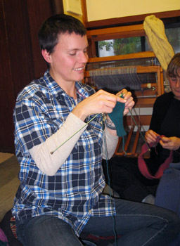 "Lauren Dito Keith: ""I taught myself out of a book in 2006, but knitted only scarves until six months ago, when I made my first hat."" Now she is finishing a pair of fingerless gloves, as one of several gift projects."