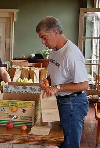 Rob Bullen preparing bag lunches for the homeless (during a previous year).